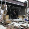 Emergency medical personnel search the Henryville Middle School room-by-room for injured people following severe storms Friday, March 2, 2012, in Henryville, Ind. Tornadoes ripped across several small southern Indiana towns on Friday, killing at least three people and leaving behind miles of flattened devastation along the border with Kentucky. (AP Photo/Timothy D. Easley) ORG XMIT: KYTE104