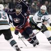 Photo - Columbus Blue Jackets' Nick Foligno (71) races through San Jose Sharks defenders Logan Couture (39) and Patrick Marleau (12) during the second period of an NHL hockey game, Monday, Feb. 11, 2013, in Columbus, Ohio. (AP Photo/Mike Munden)