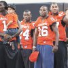 Photo - OSU's four injured starters, from left, receiver Dez Bryant, running back Kendall Hunter, cornerback Perrish Cox and defensive end Jermiah Price, stand together on the sidelines before the Cowboys' game on Saturday. Bryant and Cox should play against Texas A&M on Oct. 10, while Hunter and Price will be questionable. AP PHOTO