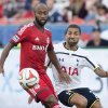 Photo - Toronto FC's Collen Warner, left, and Tottenham Hotspur's Aaron Lennon battle for the ball during the first half of a friendly soccer match in Toronto on Wednesday, July 23, 2014.  (AP Photo/The Canadian Press, Darren Calabrese)
