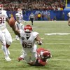 Oklahoma\'s Geneo Grissom (85) dives for the end zone over Alabama\'s Derrick Henry (27) to score a touchdown on a fumble return during the NCAA football BCS Sugar Bowl game between the University of Oklahoma Sooners (OU) and the University of Alabama Crimson Tide (UA) at the Superdome in New Orleans, La., Thursday, Jan. 2, 2014. .Photo by Chris Landsberger, The Oklahoman