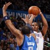 Oklahoma City\'s Russell Westbrook (0) shoots against Dallas\' Shawn Marion (0) during the NBA basketball game between the Oklahoma City Thunder and the Dallas Mavericks at Chesapeake Energy Arena in Oklahoma City, Monday, March 5, 2012. Photo by Nate Billings, The Oklahoman