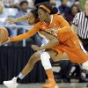 North Carolina\'s N\'Dea Bryant, left, and Clemson\'s Chelsea Lindsay, right, reach for a loose ball during the first half of an NCAA college basketball game in Chapel Hill, N.C., Thursday, Jan. 16, 2014. (AP Photo/Gerry Broome)