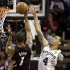 Miami Heat\'s Chris Bosh (1) shoots as San Antonio Spurs\' Danny Green (4) defends during the first half at Game 4 of the NBA Finals basketball series, Thursday, June 13, 2013, in San Antonio. (AP Photo/Eric Gay)