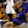 Photo - Stephen F. Austin's Antionette Carter (20) lands on top of Oklahoma State's Brittney Martin (22) during a women's college basketball game between Oklahoma State University and Stephen F. Austin at Gallagher-Iba Arena in Stillwater, Okla., Thursday, Dec. 6, 2012.  Photo by Bryan Terry, The Oklahoman