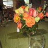 Beautiful bouquets of pink and coral-colored roses, anemones, and tulips decorated the tables for the Symphony Show House party. (Photo by Helen Ford Wallace).
