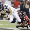 Photo - Seattle Seahawks quarterback Russell Wilson (3) is tackled by Atlanta Falcons' Akeem Dent (52) during the first half of an NFC divisional playoff NFL football game Sunday, Jan. 13, 2013, in Atlanta. (AP Photo/David Goldman)