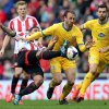 Photo - Sunderland's Liam Birdcutt, left, viies for the ball with Crystal Palace's Glenn Murray, right, during their English Premier League soccer match at the Stadium of Light, Sunderland, England, Saturday, March 15, 2014. (AP Photo/Scott Heppell)