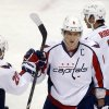 Washington Capitals\' Alex Ovechkin, center, is greeted by teammates Troy Brouwer (20) and Mike Ribeiro (9) after scoring in the third period of an NHL hockey game against the Pittsburgh Penguins on Thursday, Feb. 7, 2013, in Pittsburgh. The Penguins won 5-2. (AP Photo/Keith Srakocic)