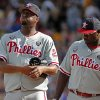 Photo - Philadelphia Phillies starting pitcher Roberto Hernandez, left, gets a visit from first baseman Ryan Howard (6) during the first inning of a baseball game against the Pittsburgh Pirates in Pittsburgh, Friday, July 4, 2014. (AP Photo/Gene J. Puskar)