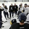 Photo - Former Buffalo Sabres player Andrew Peters, left, and Sabres players chat during an NHL hockey workout in Amherst, N.Y., Tuesday, Jan. 8, 2013. (AP Photo/David Duprey)