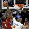 OSU\'s Matt Pilgrim blocks the shot of OU\'s Ryan Wright in the first half of the college basketball game during the men\'s Big 12 Championship tournament at the Sprint Center on Wednesday, March 10, 2010, in Kansas City, Mo. Photo by Bryan Terry, The Oklahoman