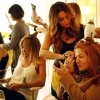 Photo - Gina Tennen, right, does her makeup as stylist Lorena Soria uses a blow dryer on her hair at Drybar salon located at 8595 West Sunset Boulevard West Hollywood, July 31, 2012. Drybar is an LA-based chain of blow dry salons, which specialize in wash only and blow dry hair.  (Al Seib/Los Angeles Times/MCT)