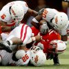 Jeremy Broadway, left, Tonga Tea Jr., and Andre Sexton of OSU tackle Quentin Castille of Nebraska during the college football game between Oklahoma State University (OSU) and the University of Nebraska at Memorial Stadium in Lincoln, Neb., on Saturday, Oct. 13, 2007. By Bryan Terry, The Oklahoman