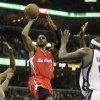 Los Angeles Clippers\' Chris Paul (3) heads to the hoop agains the Memphis Grizzlies during the first half of Game 3 in a first-round NBA basketball playoff series, in Memphis, Tenn., Thursday, April 25, 2013. (AP Photo/Danny Johnston)