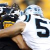 Photo -   Carolina Panthers linebacker Jordan Senn (57) hits Pittsburgh Steelers quarterback Charlie Batch (16) after Batch threw in the first quarter of their NFL preseason football game, Thursday, Aug. 30, 2012, in Pittsburgh. Senn was penalized for a late hit. (AP Photo/Keith Srakocic)