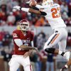 Oklahoma\'s Landry Jones (12) throws as Oklahoma State\'s Lyndell Johnson (27) tries to block the ball during the second half of the Bedlam college football game in which the University of Oklahoma Sooners (OU) defeated the Oklahoma State University Cowboys (OSU) 51-48 in overtime at Gaylord Family-Oklahoma Memorial Stadium in Norman, Okla., Saturday, Nov. 24, 2012. Photo by Steve Sisney, The Oklahoman