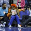 Photo - U.S. movie director and New York Knicks fan Spike Lee, center, speaks to former Knicks player Baron Davis, left, as they watch a Knicks training session at the 02 arena in London, Wednesday, Jan. 16, 2013.  The Detroit Pistons are due to play a