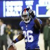 New York Giants strong safety Antrel Rolle celebrates after an interception during the second half of an NFL football game against the Green Bay Packers, Sunday, Nov. 17, 2013, in East Rutherford, N.J. The Giants won 27-13. (AP Photo/Bill Kostroun)