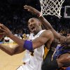 Photo - Los Angeles  Lakers guard Kobe Bryant, left, puts up a shot as Oklahoma City  Thunder forward Jeff Green defends during the first half of their NBA basketball game, Sunday, Nov. 22, 2009, in Los Angeles. (AP Photo/Mark J. Terrill)