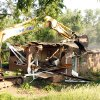 Photo - CINDY UPDEGRAFF, DEMOLISH, FLOOD DAMAGE: Cindy and Paul Updegraff's home at 641 East Brooks is demolished in Norman, Oklahoma on Friday, May 30, 2008.  The house was damaged by flooding in 2007.  BY STEVE SISNEY, THE OKLAHOMAN    ORG XMIT: KOD
