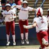 From left, OU\'s Destinee Martinez (00) and Callie Parsons (12) cheer for Brianna Turang (2) as she runs to home plate in the third inning during an NCAA softball game in the Women\'s College World Series between Oklahoma and Texas at ASA Hall of Fame Stadium in Oklahoma City, Saturday, June 1, 2013. All three Oklahoma players scored on the play. Oklahoma won 10-2 in five innings. Photo by Nate Billings, The Oklahoman