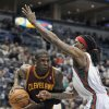 Cleveland Cavaliers\' Dion Waiters left, drives to the basket around Milwaukee Bucks\' Marquis Daniels during the first half of an NBA basketball game Saturday, Dec. 22, 2012, in Milwaukee. (AP Photo/Jim Prisching)