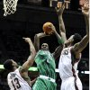 Milwaukee Bucks\' Ekpe Udoh (13) and Larry Sanders defend as Boston Celtics\' Kevin Garnett center, shoots the ball during the first half of an NBA basketball game, Saturday, Nov. 10, 2012, in Milwaukee. (AP Photo/Jim Prisching)