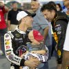 Sprint Cup Series driver Kevin Harvick (4) holds his 2-year-old son Keelan as he talks with fellow driver Tony Stewart after winning the pole for Sunday\'s Oral B USA 500 NASCAR auto race at Atlanta Motor Speedway Friday, Aug. 29, 2014, in Hampton, Ga. (AP Photo/John Bazemore)