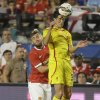 Liverpool\'s Martin Kelly, right, heads the ball against Manchester United\'s Luke Shaw, left, in the first half during the final of the Guinness International Champions Cup soccer match, Monday, Aug. 4, 2014, in Miami Gardens, Fla. (AP Photo/Lynne Sladky)