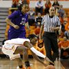 Oklahoma State\'s Toni Young (15) tries to gain control of the ball in front of Stephen F. Austin\'s Antionette Carter (20) during a women\'s college basketball game between Oklahoma State University and Stephen F. Austin at Gallagher-Iba Arena in Stillwater, Okla., Thursday, Dec. 6, 2012. Photo by Bryan Terry, The Oklahoman