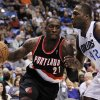 Portland Trail Blazers\' J.J. Hickson (21) looks for an opening against Dallas Mavericks\' Elton Brand (42) in the first half of an NBA basketball game, Monday, Nov. 5, 2012, in Dallas. (AP Photo/Tony Gutierrez)