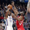 Oklahoma City \'s Kevin Durant (35) shoots over Houston\'s James Harden (13) during the NBA basketball game between the Houston Rockets and the Oklahoma City Thunder at the Chesapeake Energy Arena on Wednesday, Nov. 28, 2012, in Oklahoma City, Okla. Photo by Chris Landsberger, The Oklahoman