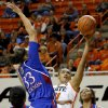 Oklahoma State\'s Kendra Suttles (31) shoots a basket between Kansas\' CeCe Harper (24), Tania Jackson (33), and Carolyn Davis (21) during a women\'s college basketball game between Oklahoma State University (OSU) and Kansas at Gallagher-Iba Arena in Stillwater, Okla., Tuesday, Jan. 8, 2013. Oklahoma State won 76-59. Photo by Bryan Terry, The Oklahoman
