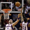 Phoenix Suns\' Marcin Gortat (4), of Poland, and Markieff Morris (11) battle for a rebound as Detroit Pistons\' Will Bynum, front right, looks on in the first half of an NBA basketball game on Friday, Nov. 2, 2012, in Phoenix.(AP Photo/Ross D. Franklin)