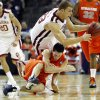 Oklahoma\'s Blake Griffin (23) trips over Syracuse\'s Rautins (1) during the second half of the NCAA Men\'s Basketball Regional at the FedEx Forum on Friday, March 27, 2009, in Memphis, Tenn. PHOTO BY CHRIS LANDSBERGER, THE OKLAHOMAN