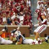 Oklahoma\'s Jalen Saunders (8) leaps over tacklers on a punt return during a college football game between the University of Oklahoma Sooners (OU) and the West Virginia University Mountaineers at Gaylord Family-Oklahoma Memorial Stadium in Norman, Okla., on Saturday, Sept. 7, 2013. Photo by Steve Sisney, The Oklahoman