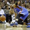 Oklahoma City\'s Russell Westbrook (0) falls down after hitting San Antonio\'s Tony Parker (9) during Game 2 of the Western Conference Finals between the Oklahoma City Thunder and the San Antonio Spurs in the NBA playoffs at the AT&T Center in San Antonio, Texas, Tuesday, May 29, 2012. Oklahoma City lost 120-111. Photo by Bryan Terry, The Oklahoman