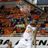 Oklahoma State\'s Markel Brown (22) dunks the ball as Texas-Arlington\'s Jamel Outler (3) watches during a college basketball game between Oklahoma State University and UT Arlington at Gallagher-Iba Arena in Stillwater, Okla., Wednesday, Dec. 19, 2012. Photo by Bryan Terry, The Oklahoman