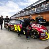 Pit crew members push Jeff Gordon\'s car for a template check before the start of qualifying for the NASCAR Sprint Cup Series auto race, Friday, March 8, 2013 in Las Vegas. (AP Photo/Julie Jacobson)
