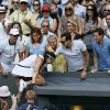 Marion Bartoli of France celebrates by climbing into the crowd after winning the Women\'s singles final match against Sabine Lisicki of Germany at the All England Lawn Tennis Championships in Wimbledon, London, Saturday, July 6, 2013. (AP Photo/Stefan Wermuth, Pool)