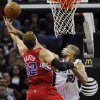 San Antonio Spurs\' Tim Duncan, right, defends against Los Angeles Clippers\' Blake Griffin during the first half of an NBA basketball game, Monday, Nov. 19, 2012, in San Antonio. (AP Photo/Darren Abate)