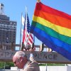 Photo - Atlantic City Mayor Don Guardian affixes a flag in Atlantic City, N.J., Monday June 16, 2014. Atlantic City is planning a series of events to attract gay tourists, who are becoming an increasingly important part of the resort's growth strategy. (AP Photo/Wayne Parry)