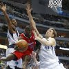 Photo - Dallas Mavericks forwards Jae Crowder (9) and Dirk Nowitzki (41) defend as Los Angeles Clippers guard Darren Collison passes under the basket during the first half of an NBA basketball game Friday, Jan. 3, 2014, in Dallas. (AP Photo/Sharon Ellman)