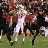 A dejected Stanford\'s Daniel Zychlinski (36) grabs his helmet as Oklahoma State\'s Jamie Blatnick (50) and Justin Gilbert (4) celebrate a missed Stanford field goal attempt during overtime in the Fiesta Bowl NCAA college football game Monday, Jan. 2, 2012, in Glendale, Ariz. Oklahoma State defeated Stanford 41-38 in overtime.(AP Photo/Ross D. Franklin) ORG XMIT: PNP158