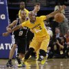 San Antonio Spurs\' Tony Parker (9) and Golden State Warriors\' Jarrett Jack, right, eye a loose ball during the second half of an NBA basketball game Friday, Feb. 22, 2013, in Oakland, Calif. (AP Photo/Ben Margot)