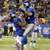 New York Giants running back Ahmad Bradshaw, right, celebrates with teammate Martellus Bennett, left, after scoring a touchdown during the first half of an NFL football game, Sunday, Nov. 25, 2012, in East Rutherford, N.J. (AP Photo/Bill Kostroun)