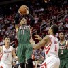 Milwaukee Bucks guard Monta Ellis (11) shoots against Houston Rockets forward Greg Smith (4) during the first half of an NBA basketball game, Wednesday, Feb. 27, 2013 in Houston. (AP Photo/Bob Levey)