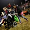 Chris Schatz reacts as he is pushed onto the field by nurse Sydney Stell (right) and music therapist Rachel Nowels at halftime of the high school football game between Bethany and Washington in Bethany, Okla., on Friday, September 16, 2011. Residents of The Children\'s Center played drums with the high school bands from Washington and Bethany. Photo by John Clanton, The Oklahoman