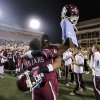 Jenks\' Jordan Smallwood (2) and Trey\'Vonne Barr\'e (5) celebrate the win over Norman North during the Class 6A Oklahoma state championship football game between Norman North High School and Jenks High School at Boone Pickens Stadium on Friday, Nov. 30, 2012, in Stillwater, Okla. Photo by Chris Landsberger, The Oklahoman